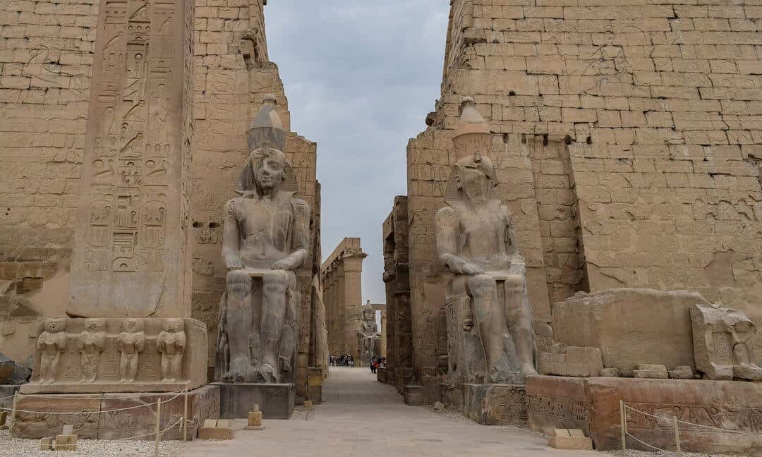 The remains of the removed obelisk and the remaining obelisk in situ at the Luxor Temple, Egypt.