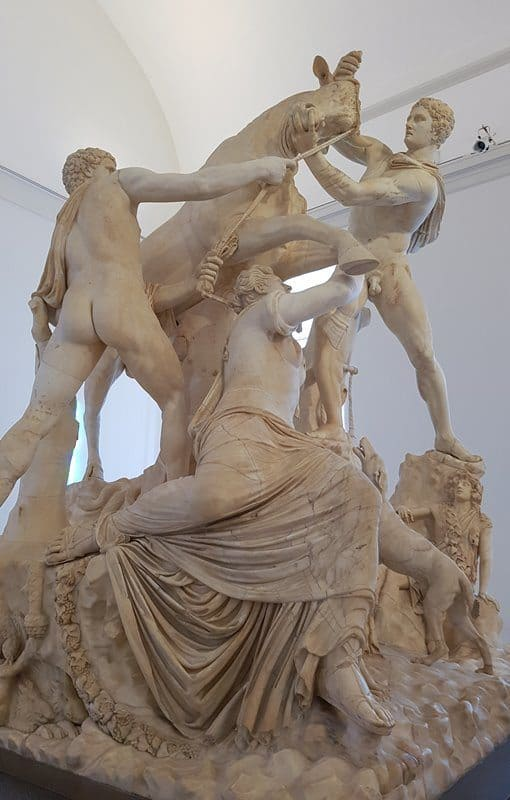 A closeup of the Farnese Bull showing Amphion and Zethus grappling with the bull to which they tie Dirce.