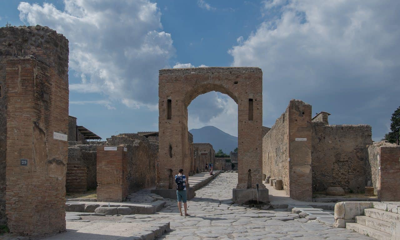 Archi Onorari at Pompeii, with Vesuvius in the background.