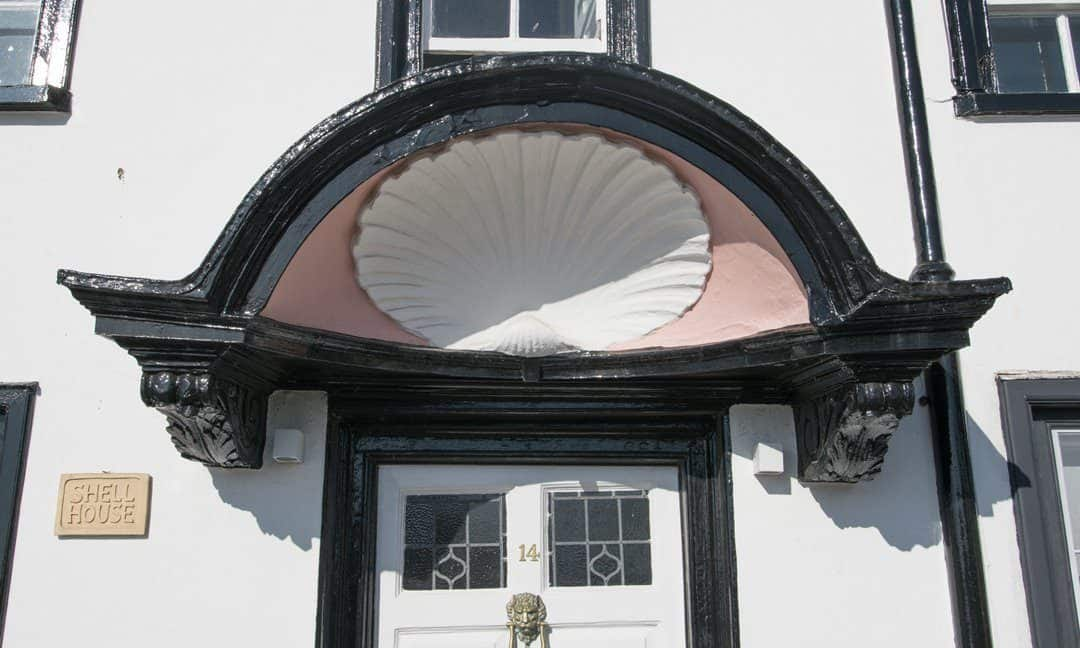 The shell above the door of the aptly named Shell House in Topsham.