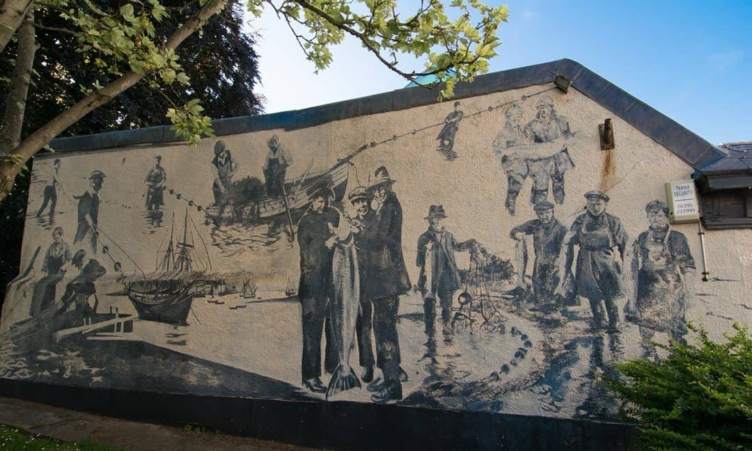 A painted mural depicting the fishing heritage of the town of Topsham.