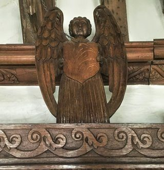 Carved wooden angel at Tuckers Hall Exeter.