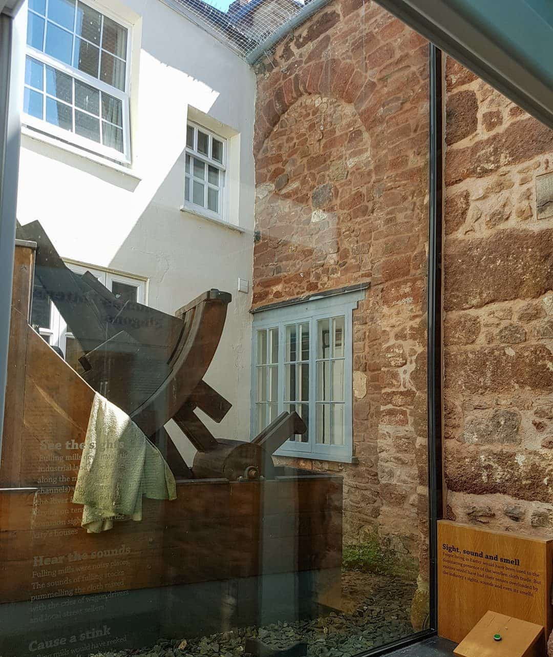 View of Old church window and fulling stocks at Tuckers Hall in Exeter.