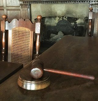Wooden gavel at the head of the table at Tuckers Hall in Exeter.