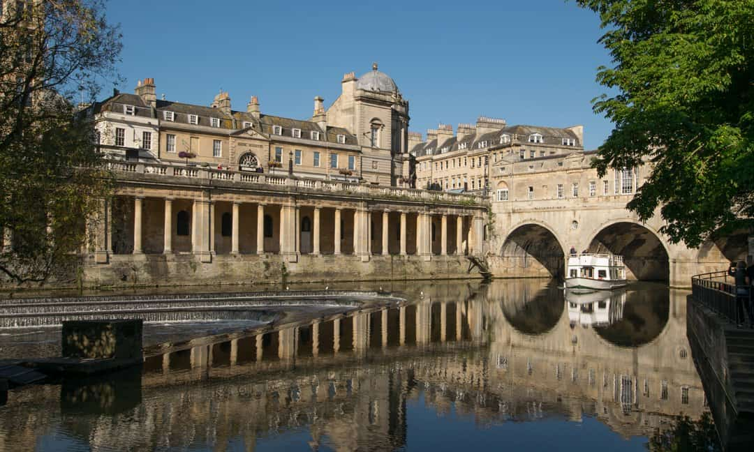 A river cruise boat coming through Pulteney Bridge, Bath.