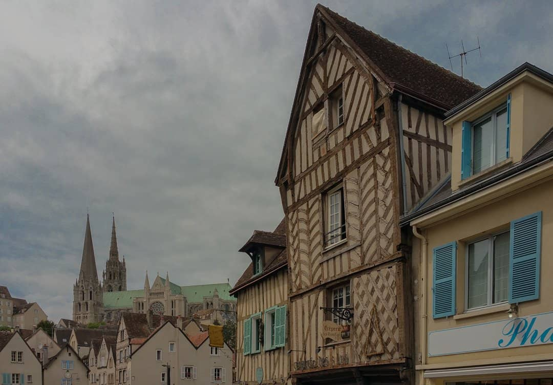 A view of Chartres Cathedral with timber-framed buildings in Chartres.