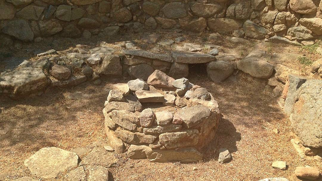 A view of a building called the 'meeting hut' at Nuraghe la Prisgiona in Sardinia.