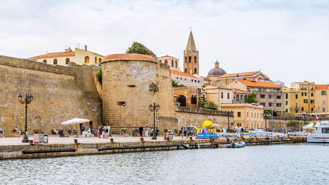 A view of Torre della Maddalena from the water's edge in Alghero, Sardinia.