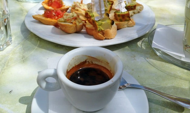 A fresh espresso ordered at a cafe in one of Olbia's many piazzas