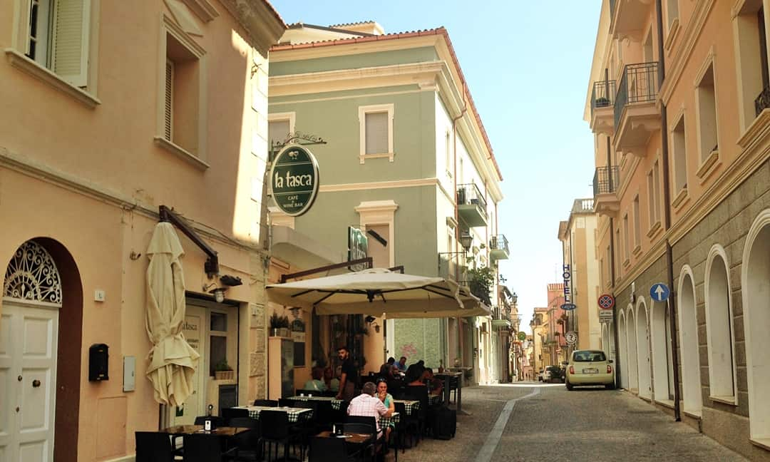 A side street view with a local cafe in Olbia, Sardinia
