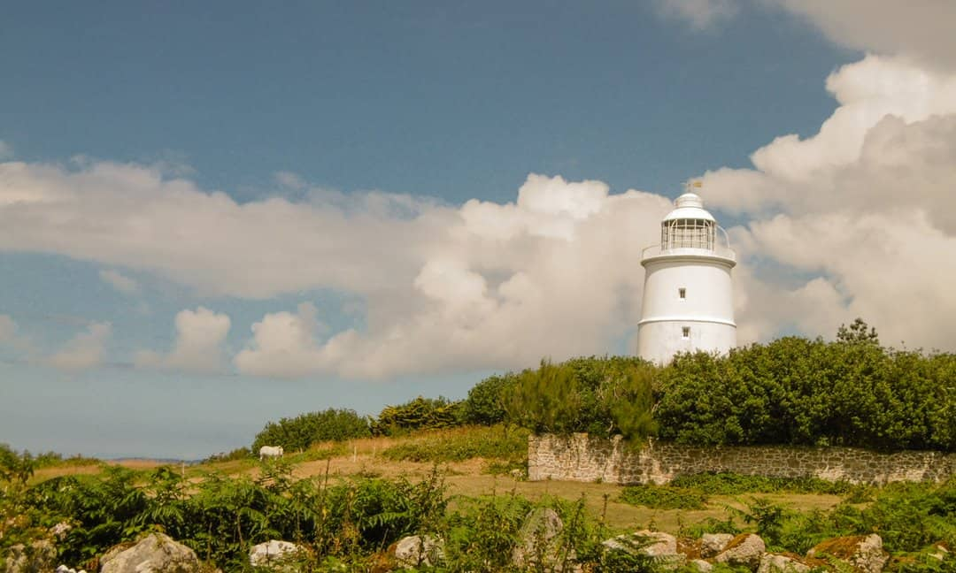 The striking white lighthouse on St Agnes, Isles of Scilly.