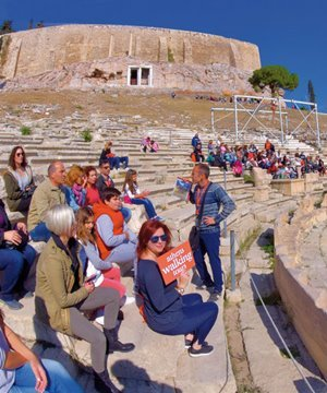 A tour group in the Theatre of Dionysus, below the Acropolis.
