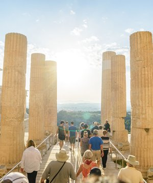 The setting sun through the columns of the propylaea on he Acropolis.