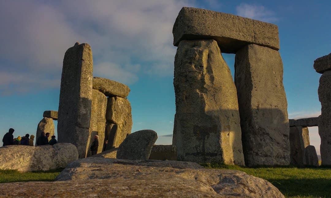 Inside the circles of stone at Stonehenge at dawn.