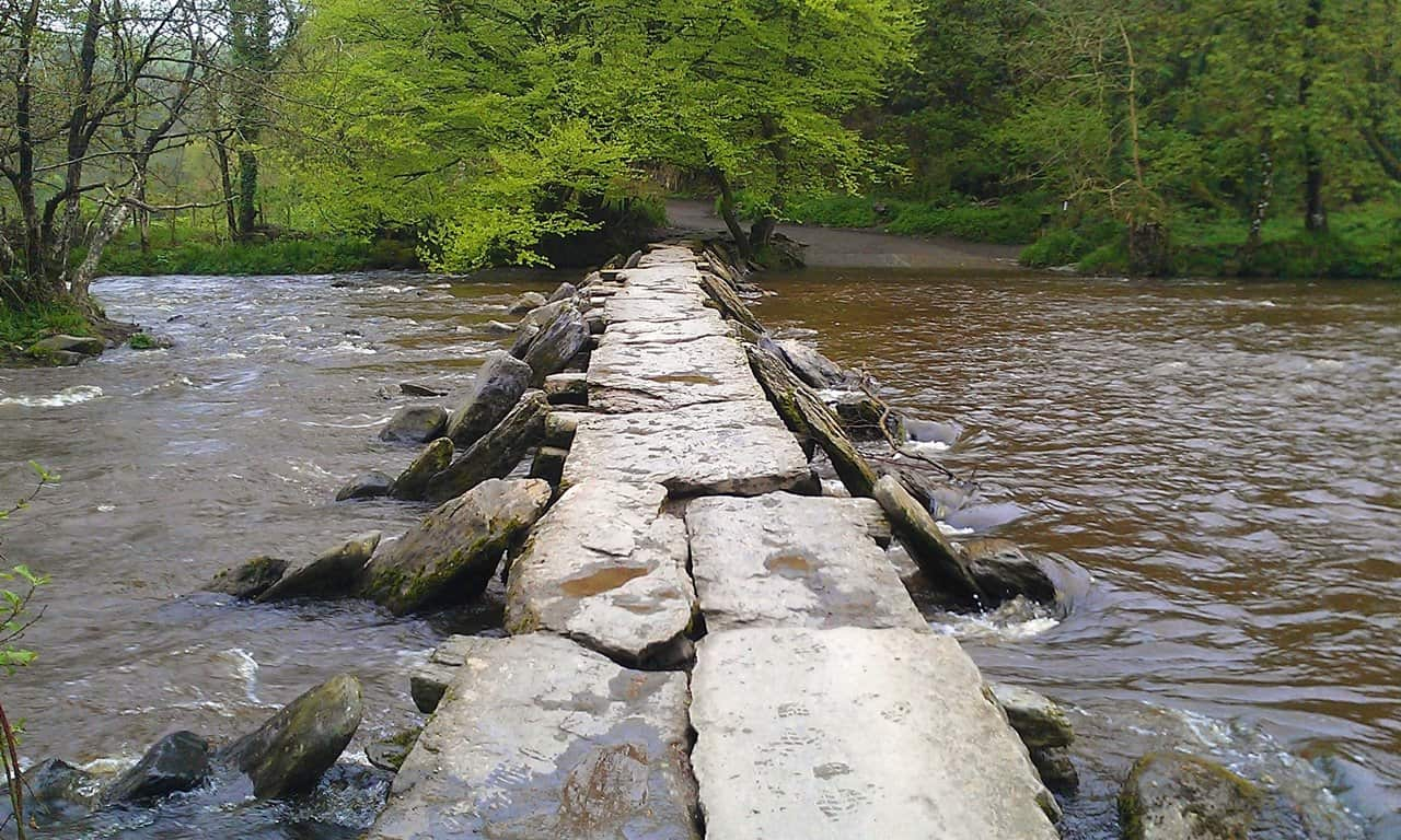 The Tarr Steps the longest and perhaps oldest Medieval clapper bridge in Britain.