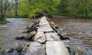 The Medieval Tarr Steps in Exmoor National Park.