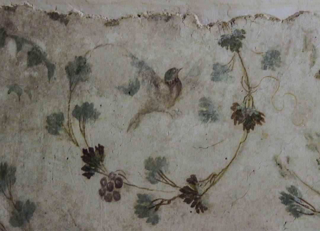 Fresco of a bird and wild flowers in Case Romane del Celio, Rome.