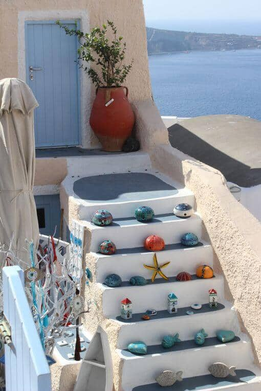 Outside steps covered with small items for sale.