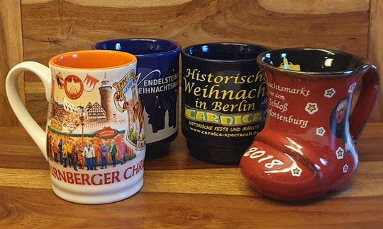A selection of souvenir gluhwein mugs from German Christmas Markets.