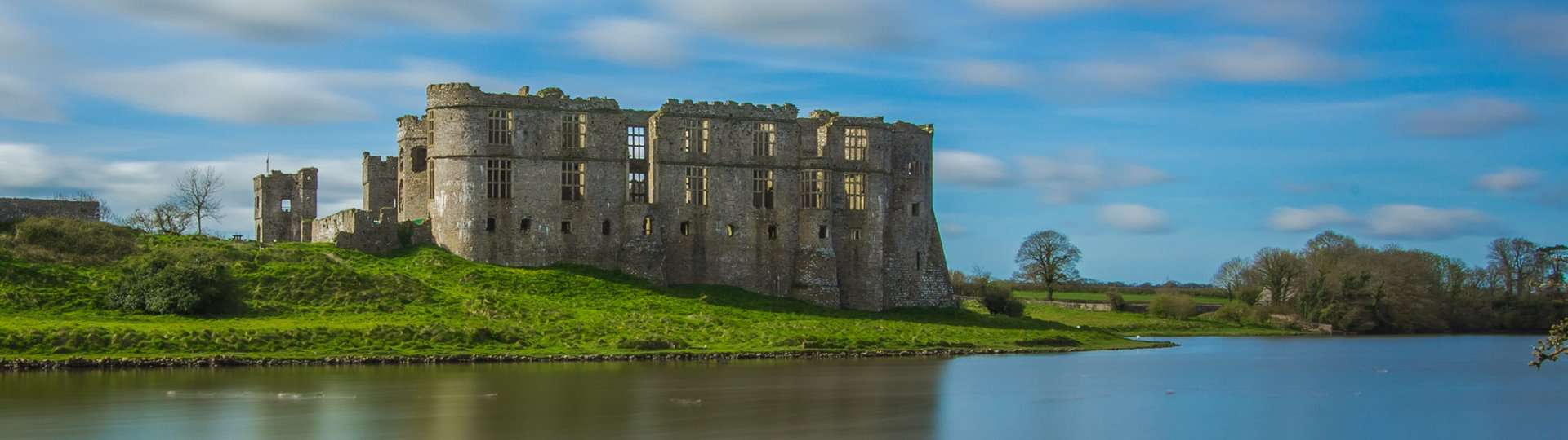 Carew Castle on the banks of the Carew River.