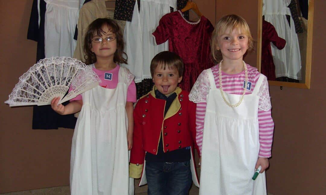 Kids at the dressing up box in Salisbury Museum.