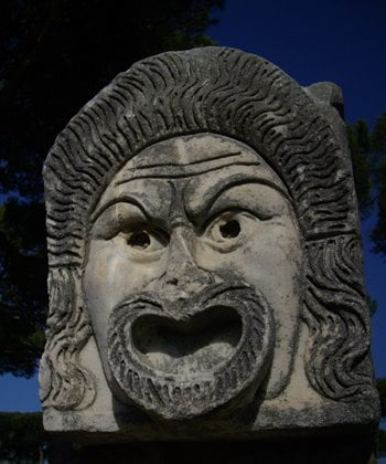 Mask sculpture at the theatre in Ostia Antica, Rome.