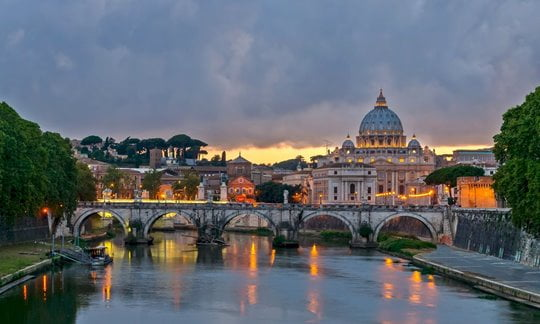 Saint Angelo Bridge in Rome at dusk.