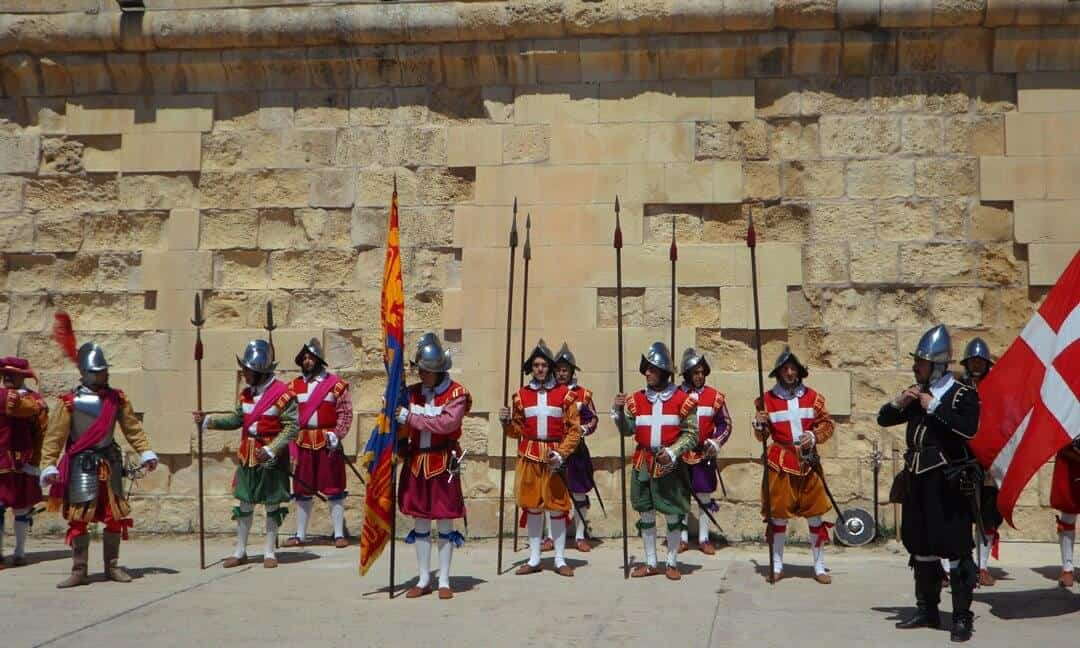 Reenactors of the Knights of St. John in front of a fort in Valetta.