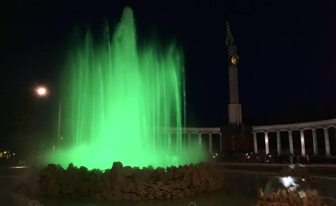 Illuminated fountain at night in Vienna.