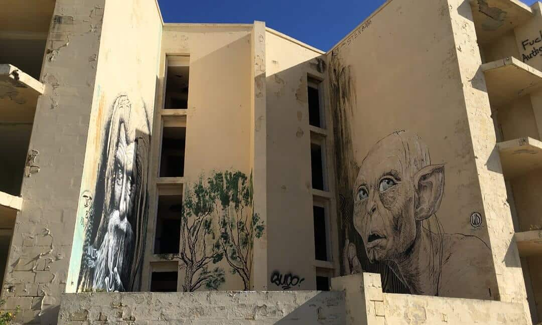 Graffiti on the outside walls of the abandoned Jerma Palace Hotel in Malta.