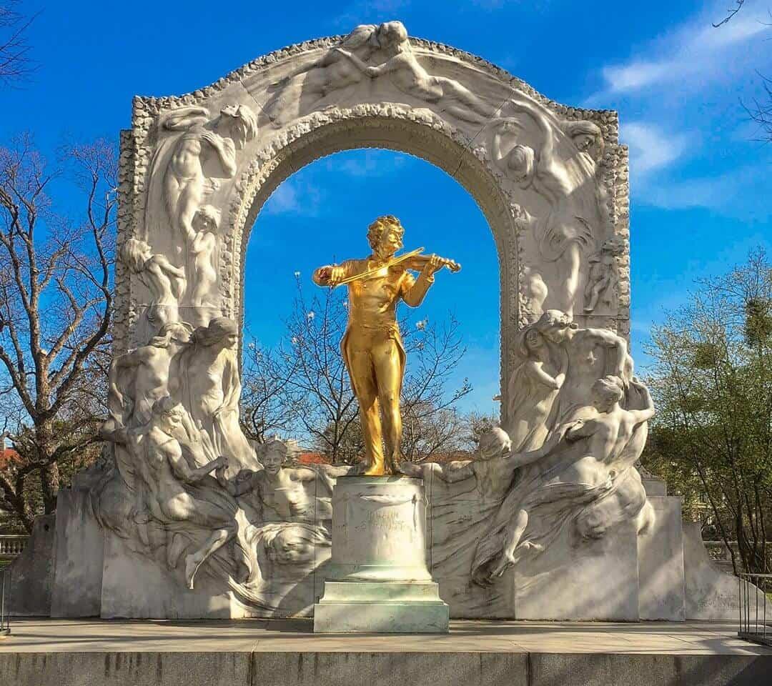 The golden baroque statue of Johann Strauss in Stadtpark Vienna.