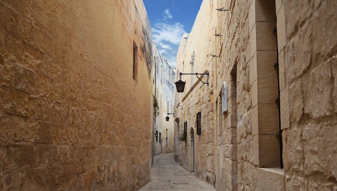 A narrow street inside Mdina the ancient capital of Malta.