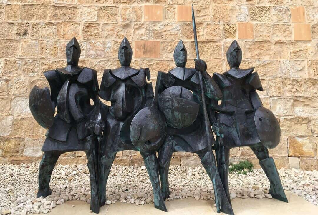A sculpture of four knights in armour at the National War museum in Malta.