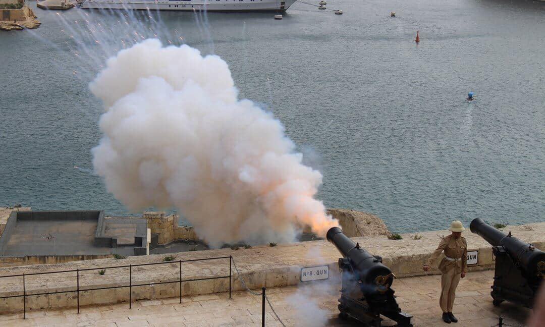 The canon being fired by a soldier at the Saluting Battery, Valetta.