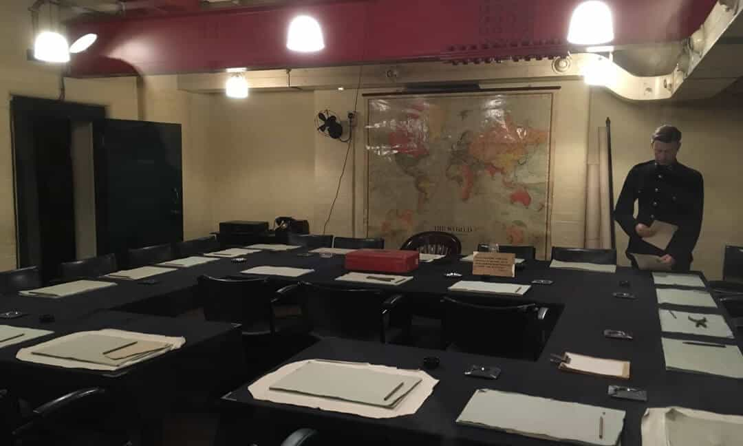 The cabinet meeting room inside the Churchill war rooms showing tables and chairs laid out for a meeting