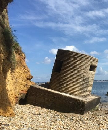 Remains of a D-Day Pill box on the beach at Studland Bay, England.