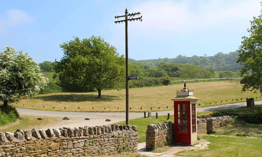 A phone box and telegraph pole at the ghost village of Tyneham in Dorset