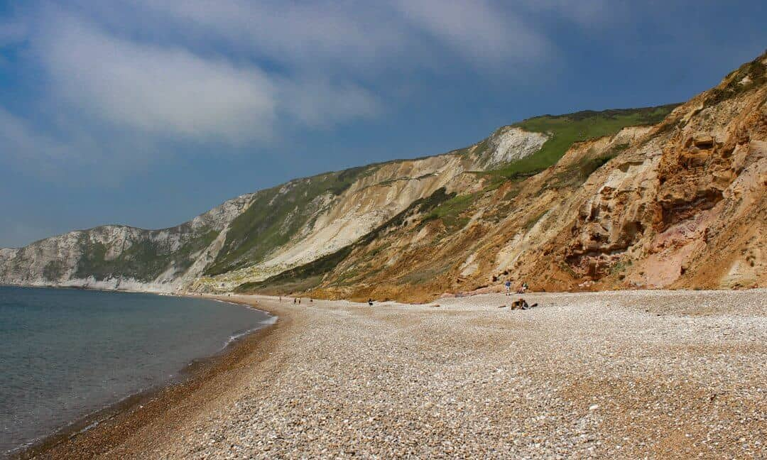 The blue sea, pebbled beach and cliffs of Worbarrow Bay.