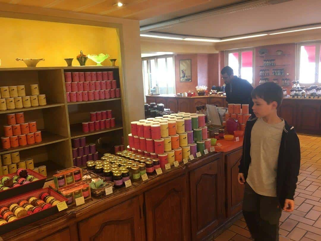 My son looking at assorted colourful jars in the chocolate shop