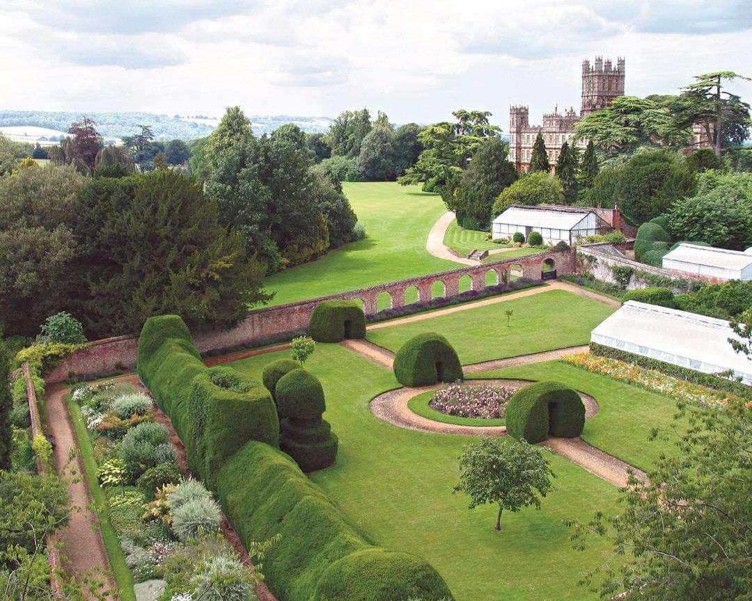 A drone view over the walled monks gardens with the castle in the background