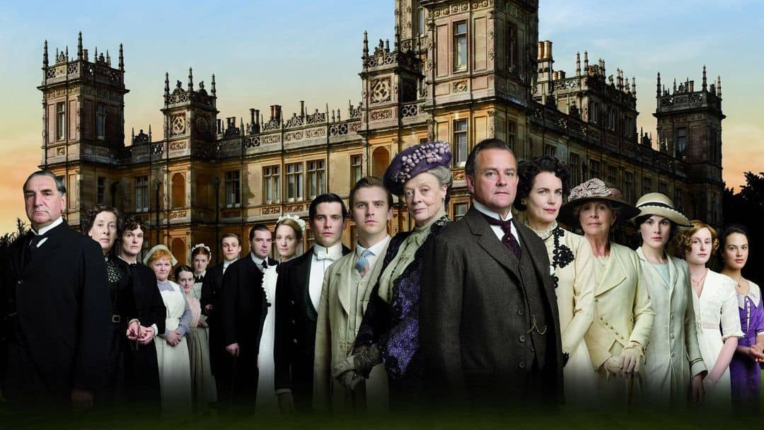 The cast of Downton Abbey outside Highclere Castle in a publicity photo.