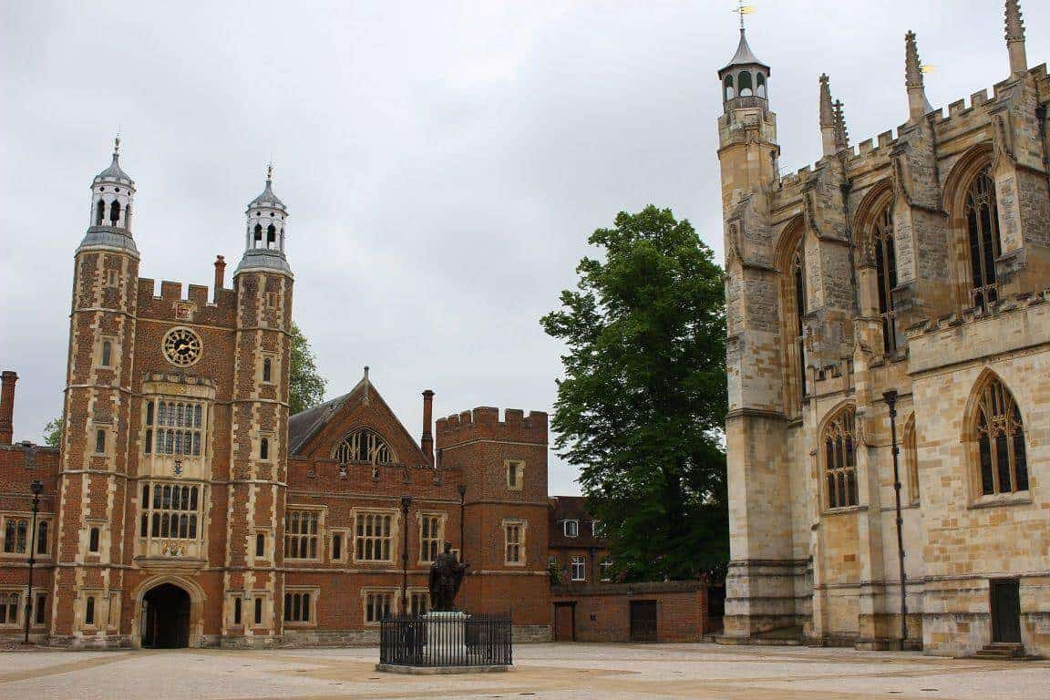 The gatehouse, chapel and statue of King Henry VI in the school yard.