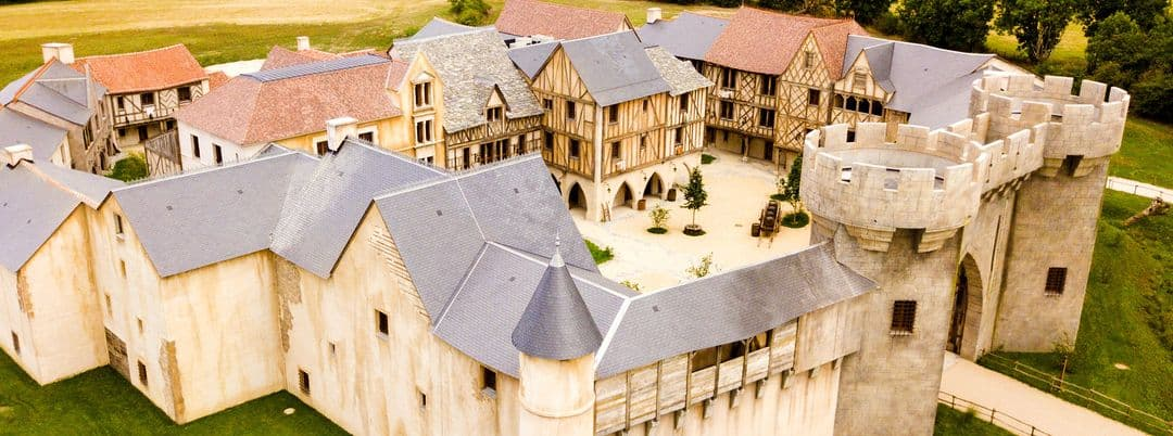 The Medieval hotel showing castle turrets, a portcullis and internal courtyard.