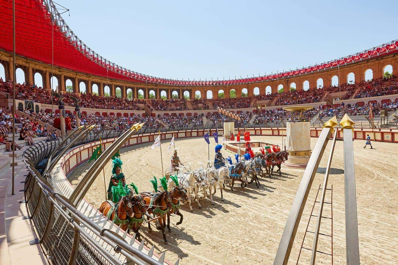 Horses and charioteers lining up for a race in a Roman amphitheatre.