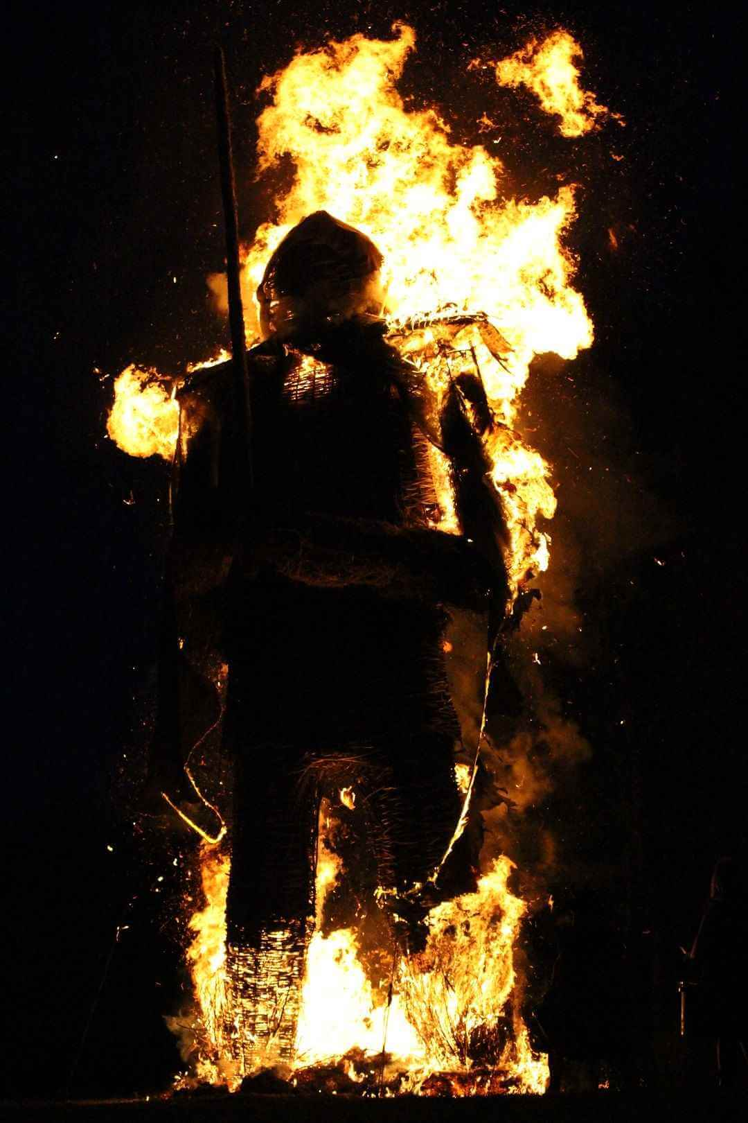 The burning Wicker Man covered in flames.