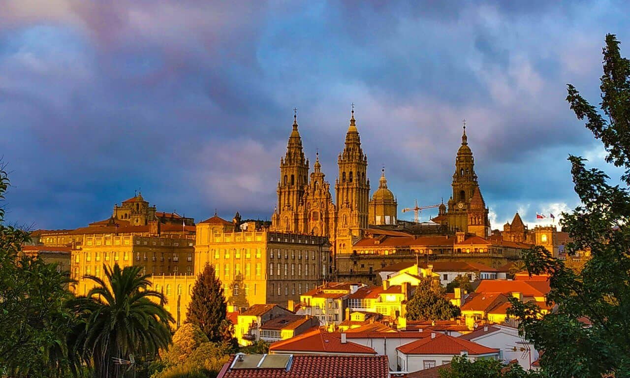 The skyline of Santiago de Compostela's old town at sunset.