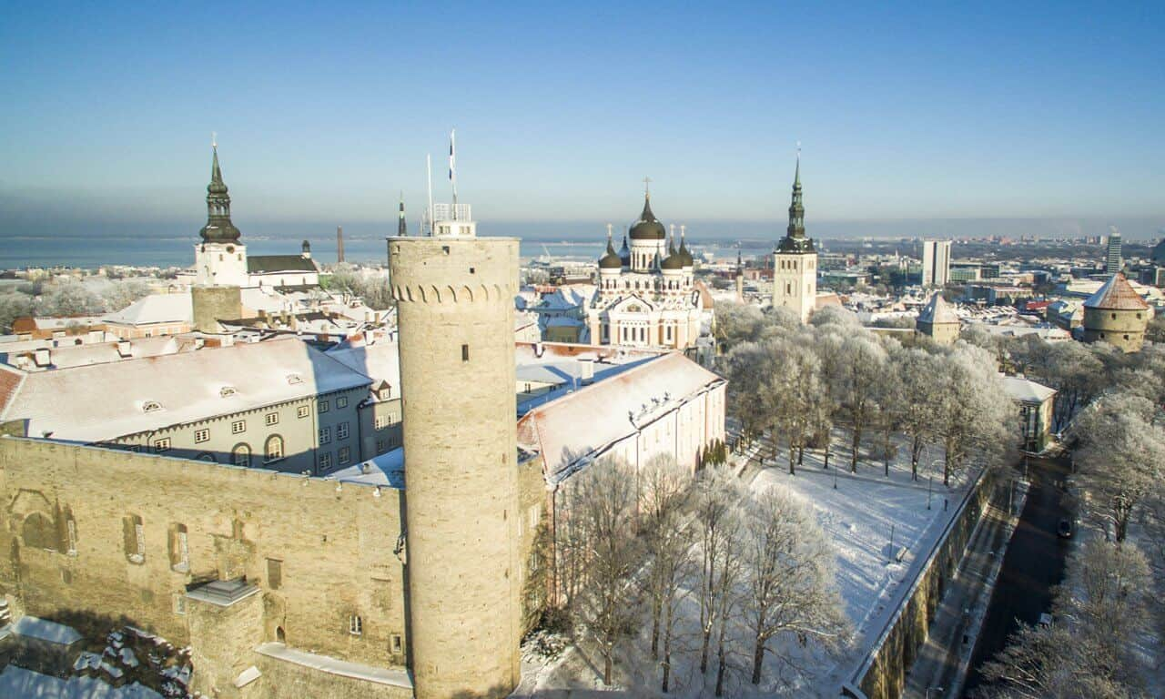 An aerial view of the historic centre of Tallinn, Estonia, showing the Medieval castle and many church spires.
