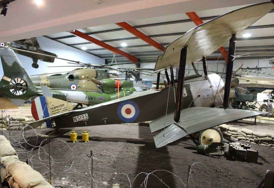 A Sopwith plane in an aircraft hangar.