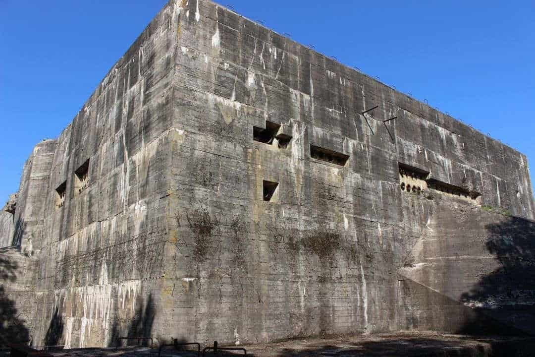 A huge square concrete bunker against a blue sky.