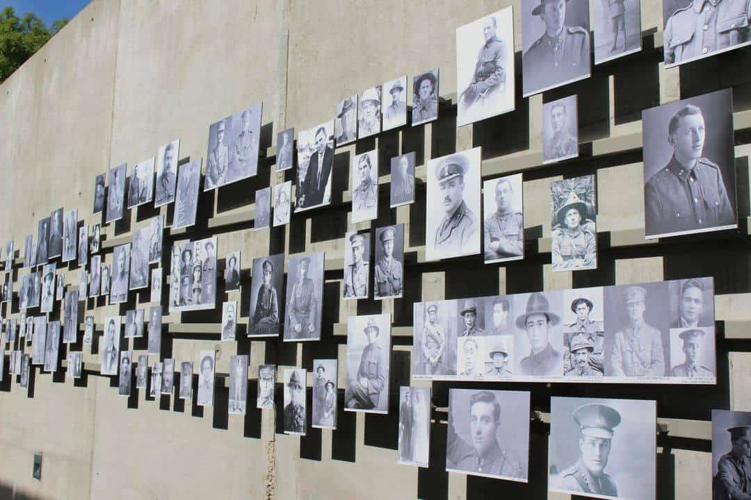 A wall of black and white photos of New Zealand tunnellers in World War I.